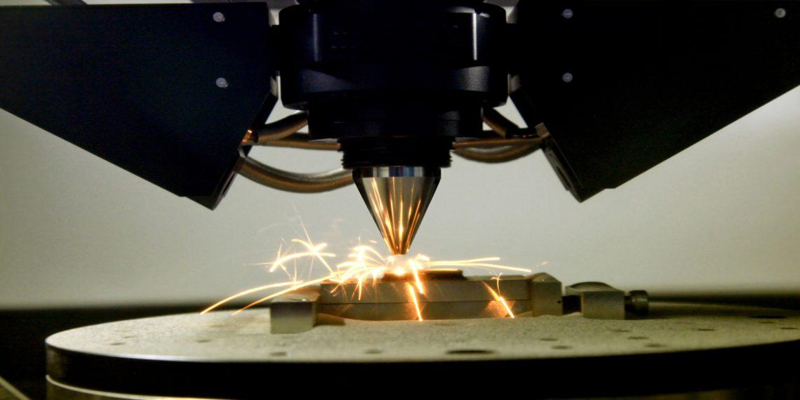 detail of 3d printer printing a metal piece