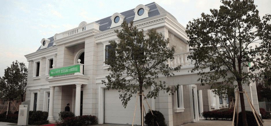 Two story 3D printed villa developed by Winsun. Photo curtesy Winsun