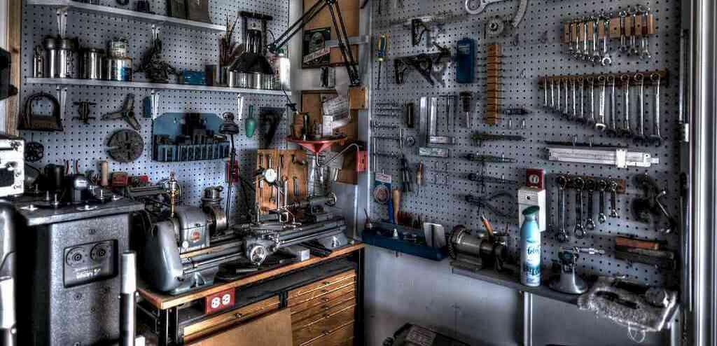 Machine room with benchtop metal lathe. photo credit: mtneer_man